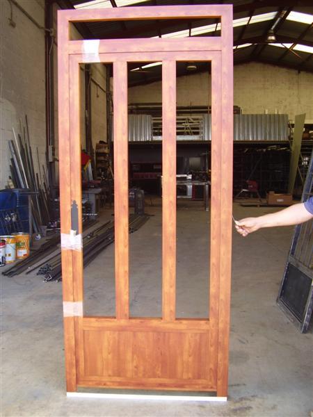 Cerrajer a gil carpinter a de hierro y aluminio vall d - Puertas de aluminio imitacion madera ...