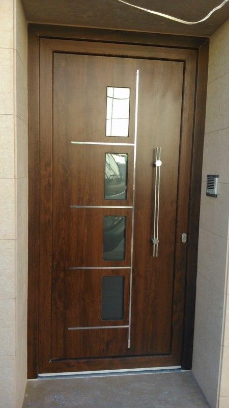 Cerrajer a gil carpinter a de hierro y aluminio vall d for Puertas imitacion madera exterior